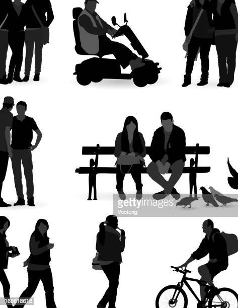 Silhouette of several sets of casual people