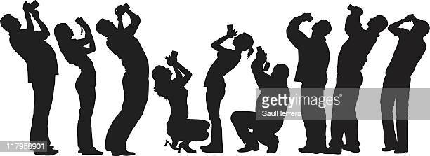 A silhouette of various people shooting up