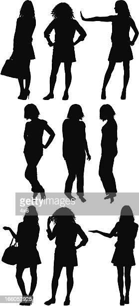 Silhouette of women standing
