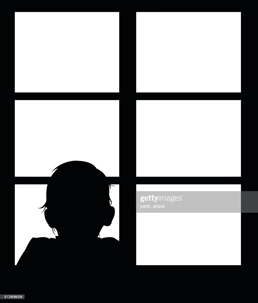 Silhouette of young baby looking out window.