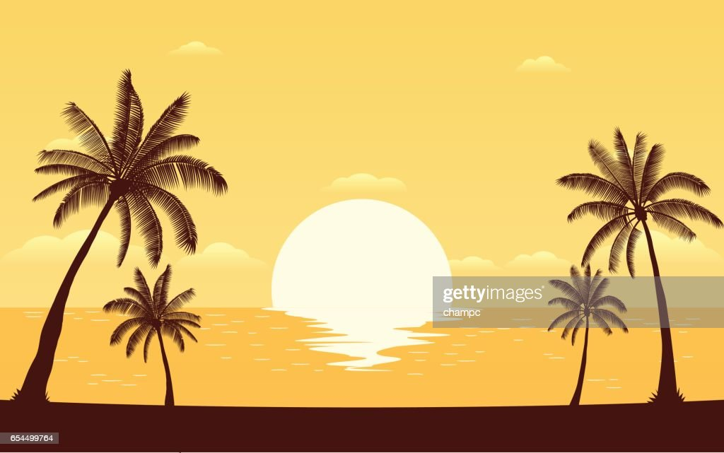 Silhouette palm tree on beach with sunset sky