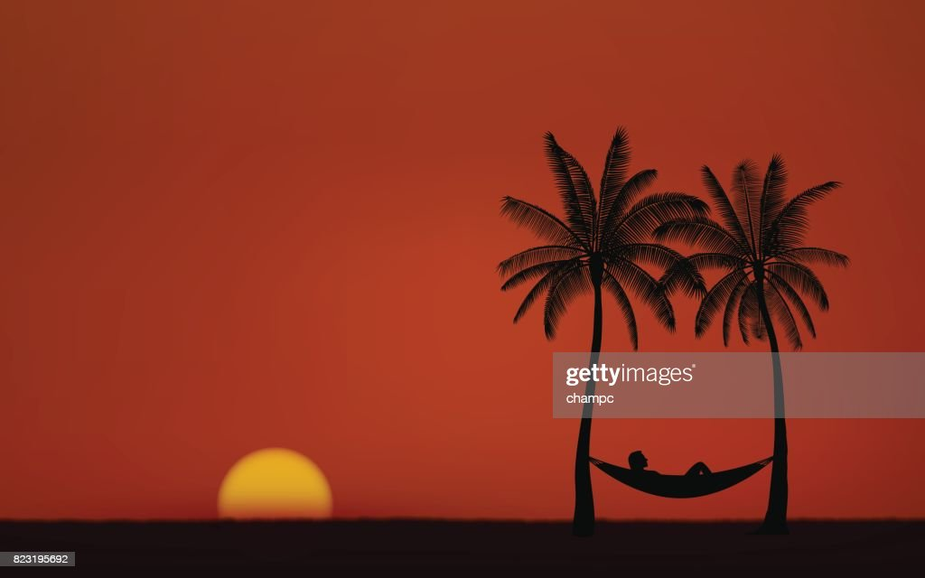 Silhouette palm tree with hammock on beach under sunset sky background