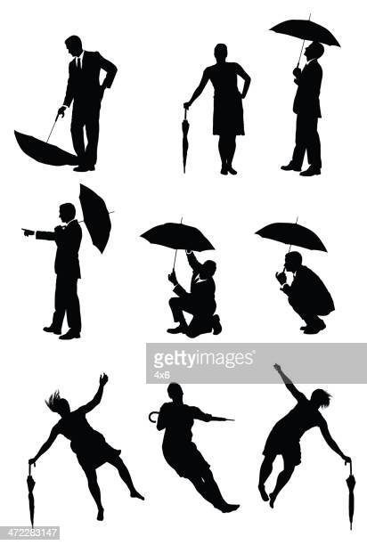 silhouette people posing with umbrellas - crouching stock illustrations, clip art, cartoons, & icons