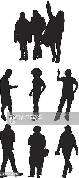 silhouette people walking and standing - afro stock illustrations