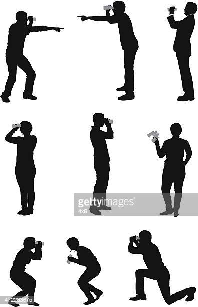 Silhouette people with binoculars