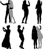 Silhouettes  man and woman taking selfie with smartphone