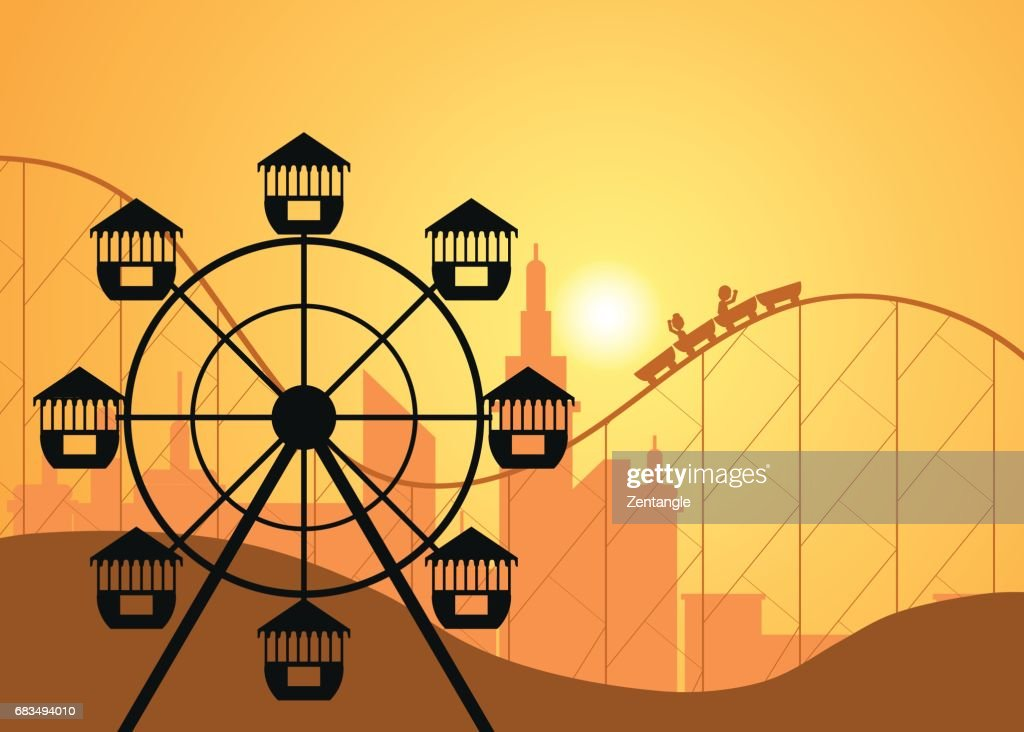 Silhouettes of a city and amusement park with the Ferris wheel .