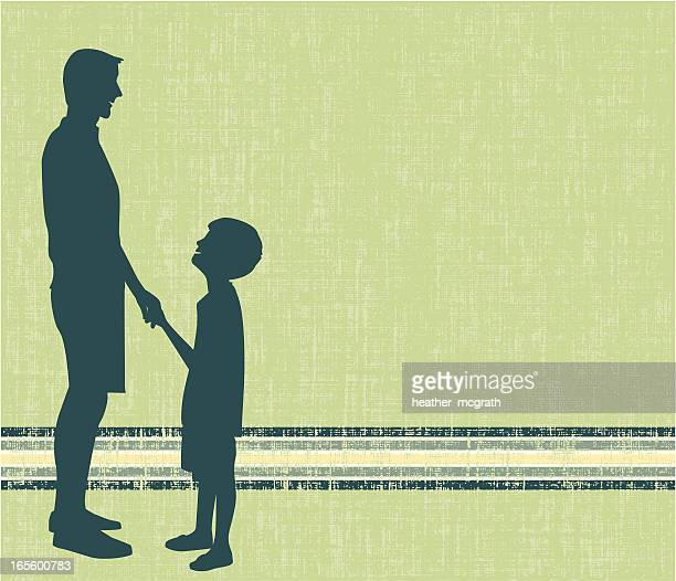 Silhouettes of a father and son