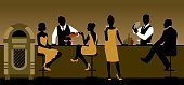 Silhouettes of a group of people drinking in a bar