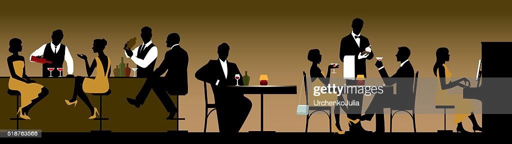 Silhouettes of a group of people holiday makers in a restaurant