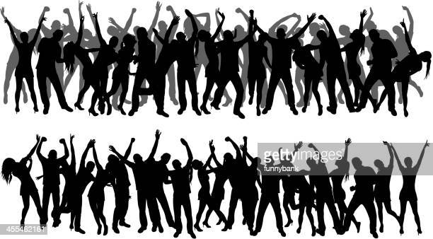 Silhouettes of a large group of people dancing