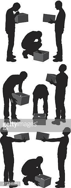 Silhouette d'un homme avec boîte