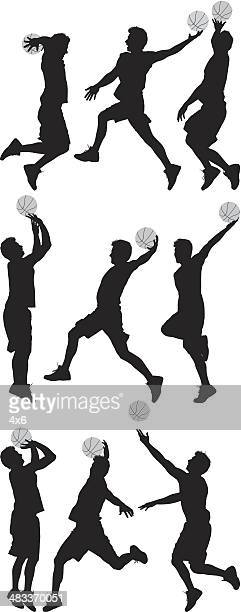Silhouettes of active sportsman playing basketball