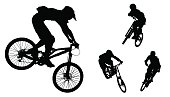 Silhouettes of bikers