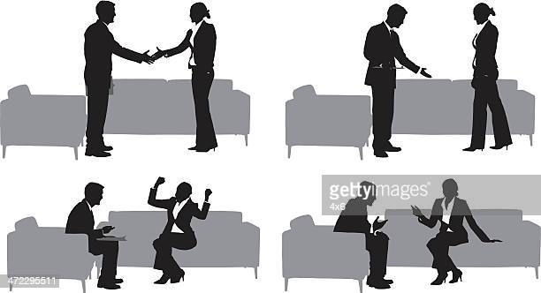 Silhouettes of businessman and woman