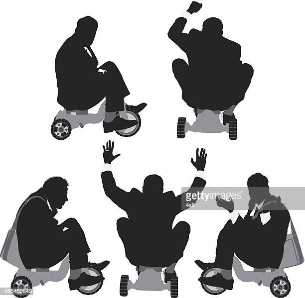 Silhouettes of businessmen riding a tricycle