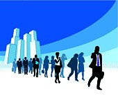 Silhouettes of businesspeople walking away from building