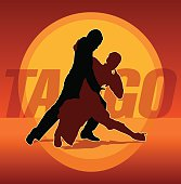 Silhouettes of couple dancing argentine tango