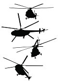 Silhouettes of flying helicopters