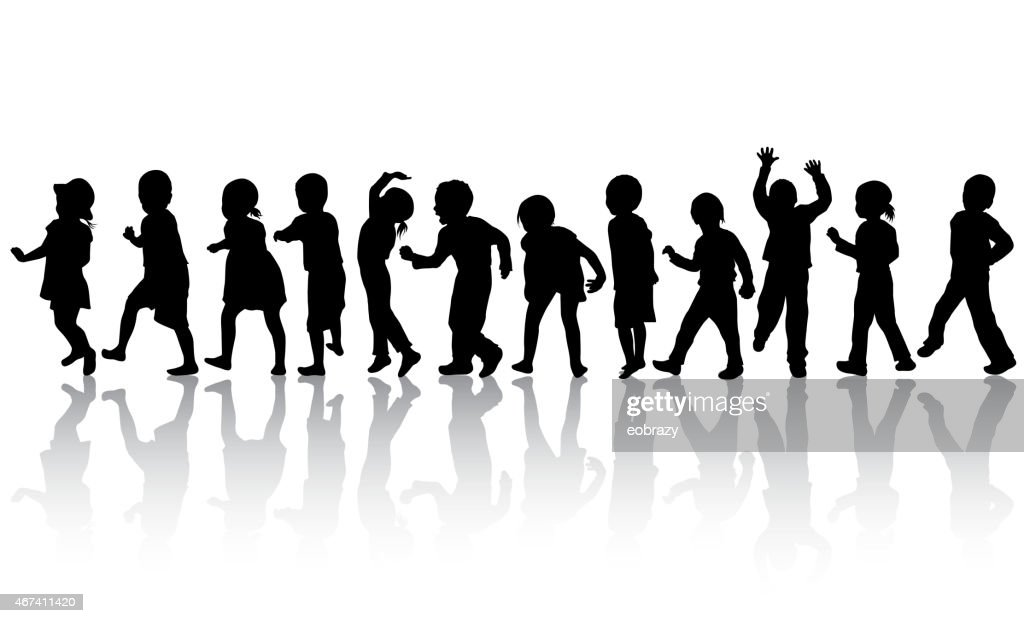 Silhouettes of happy children dancing together
