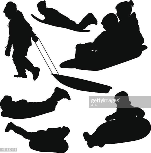 silhouettes of kids sledding - tobogganing stock illustrations, clip art, cartoons, & icons