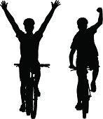 Silhouettes of mountain bike cyclists winning the race