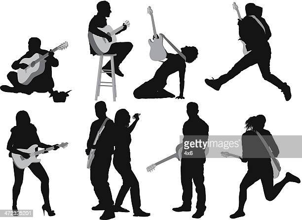 silhouettes of people playing guitar - guitarist stock illustrations, clip art, cartoons, & icons