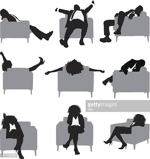 Silhouettes of people sitting in an armchair