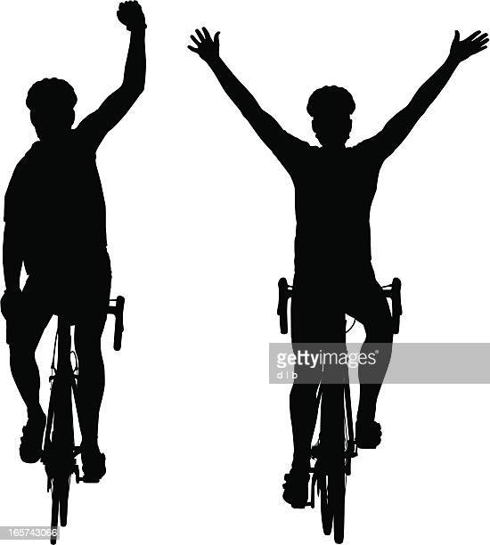 Silhouettes of road bike cyclists winning the race