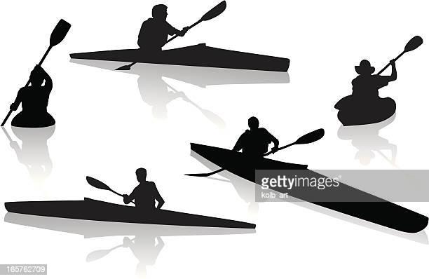 Silhouettes of single kayakers kayaking