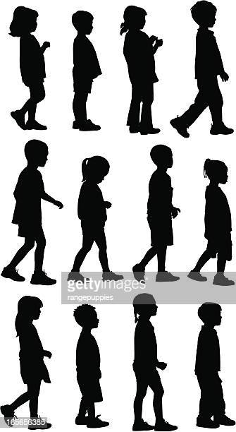 silhouettes of small children walking on a white background - side view stock illustrations