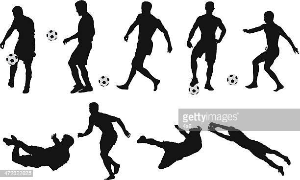 silhouettes of soccer player - heading the ball stock illustrations
