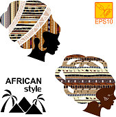 Silhouettes of the head of an  African girls