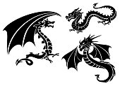 Silhouettes of three dragons