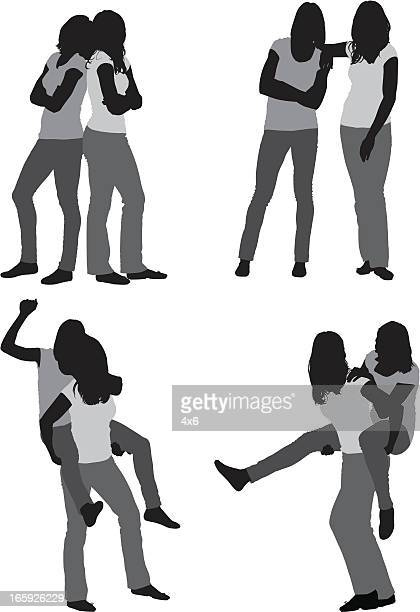 silhoutte of female friends posing - piggyback stock illustrations, clip art, cartoons, & icons