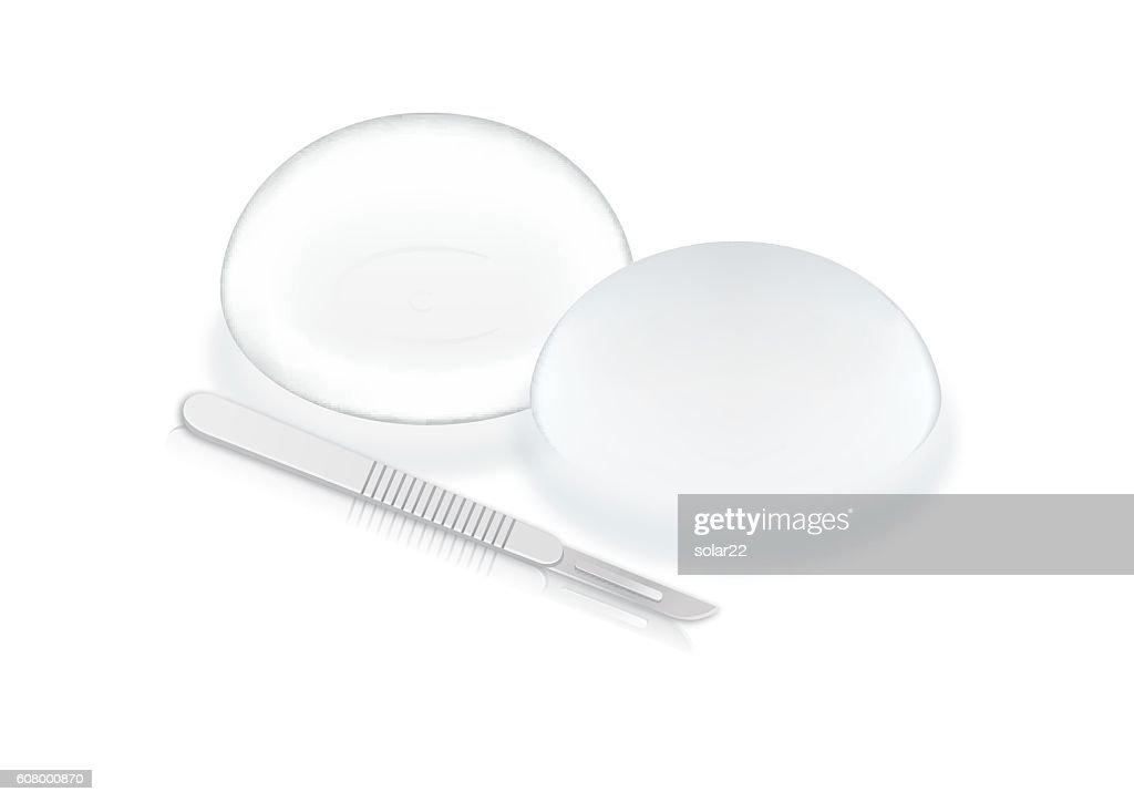 Silicone breast implants and scalpel blade.