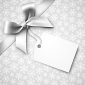 Silver Holiday Background with Silver Bow and Tag