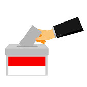 simple concept, man hand using tuxedo give a paper vote at indonesia election