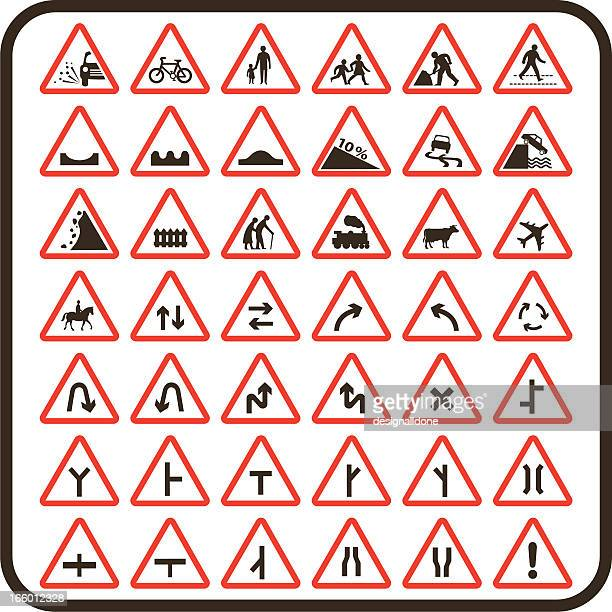 simple uk road signs: cautionary series - zebra crossing stock illustrations