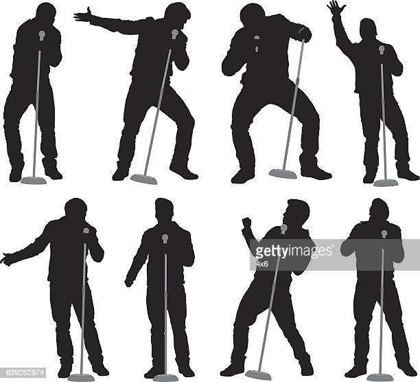 singer singing with microphone - unrecognisable person stock illustrations