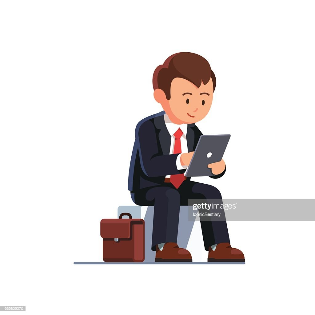 Sitting business man using his tablet computer