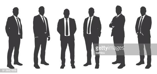 six businessmen sihouettes - businessman stock illustrations