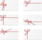 Six notes with red and white ribbon bows
