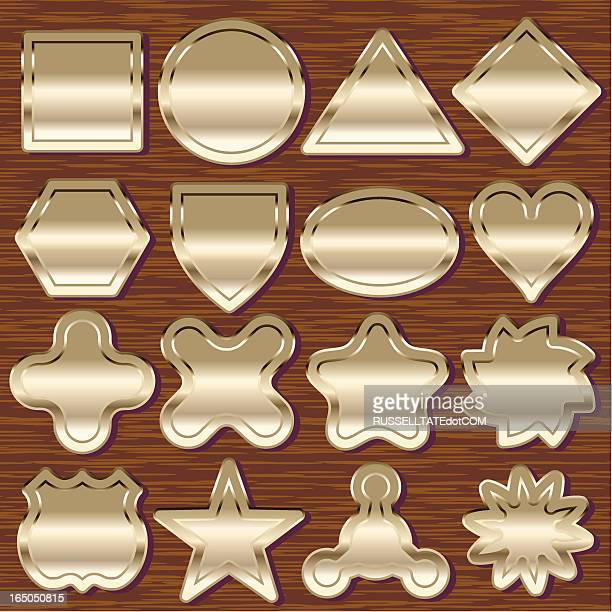 Sixteen Brass Emblems on Wood