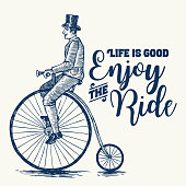 Sketch of Victorian man riding a penny farthing bicycle with text life is good enjoy the ride, vector illustration and clip-art.