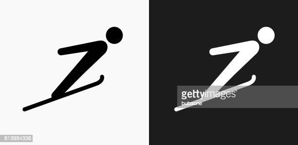ski jump icon on black and white vector backgrounds - ski jumping stock illustrations