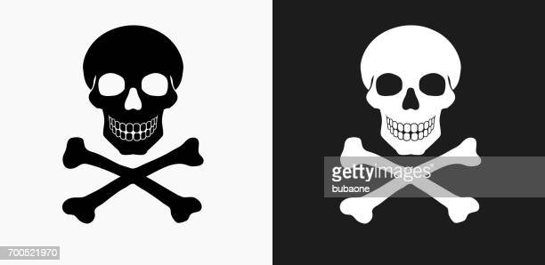 skull and crossbones icon on black and white vector backgrounds - skull stock illustrations, clip art, cartoons, & icons