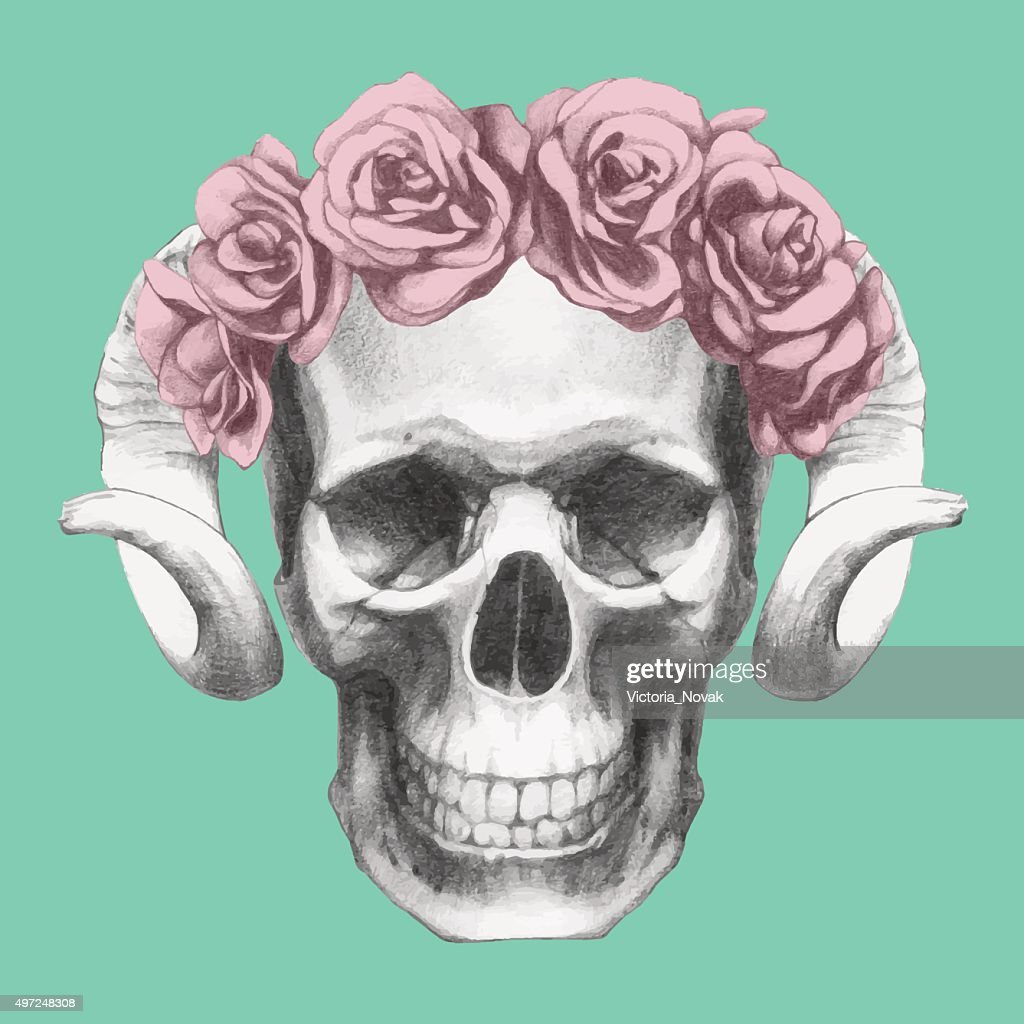 Skull with horns and floral head wreath.