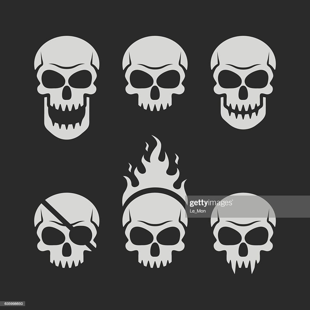 Skulls set on black background