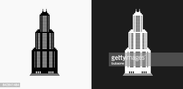 Skyscraper Icon on Black and White Vector Backgrounds